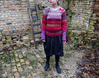 Handmade knitted bright red and grey striped natural wool sweater with flower pattern in sleeves