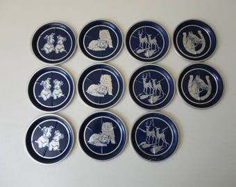VINTAGE collection of 11 blue and silver aluminum ANIMAL COASTERS - dogs cats deer horses
