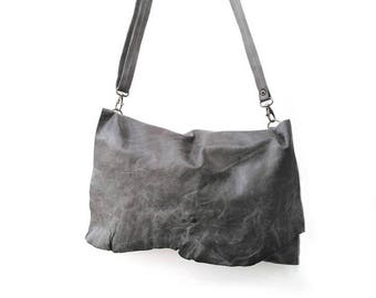 Moss green leather clutch with irregular flap