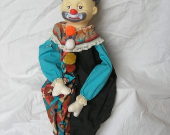 Turquois and Black Seated Harlequin Clown