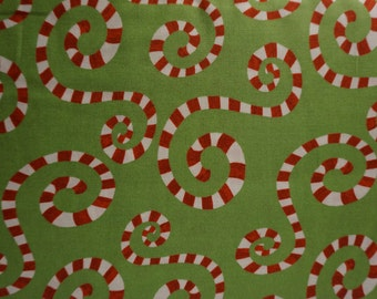 It's Christmas! Candy Canes (green background); sold by the yard