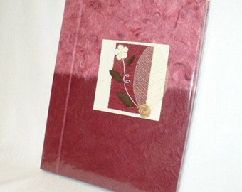Handmade paper journal, hand bound and decorated cover