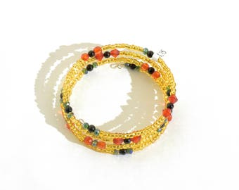 Golden, Red, Green and Black Beaded Wrap-Around Bangle- crafted by Nepalese human trafficking victims