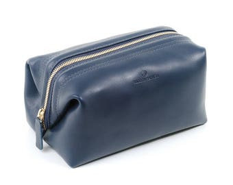 Navy blue leather dopp kit for men and women. Cosmetic case or toiletry bag made with leather and handcrafted in Los Angeles.