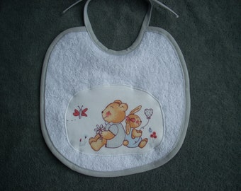 Bib 1 age sponge with bunny and teddy bear applique patterns.
