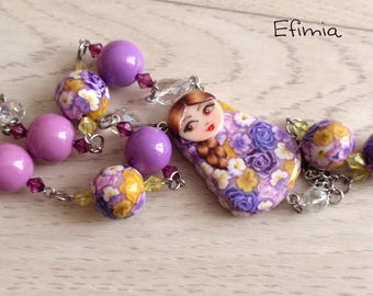 Matryoshka (nesting doll) necklace colors purple, lilac and pastel yellow beads with the same pattern, polymer clay
