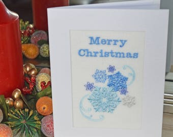 A new machine embroidered hand finished Christmas card -- Snowflakes.