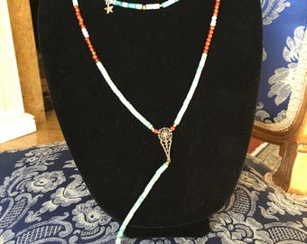Green and coral color long necklace