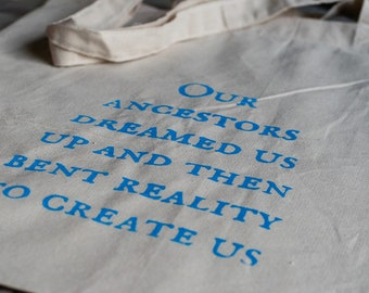 our ancestors dreamed us up and then bent reality to create us tote bag