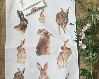 Hare tea towel. mixed hare tea towel. Tea towel with mixed hares. Hare watercolour tea towels. wildlife gift. hare gift. hare present. hare