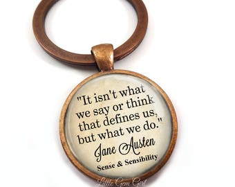 Jane Austen Quote Jewelry - It isn't what we say or think that defines us Inspirational Book Quote Necklace or Key Chain Charm Austen Gifts