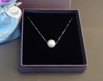 Silver necklace with a floating white freshwater pearl