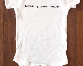 Love Grows Here Baby Onesie