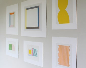 Mid century modern art, gallery wall, feature wall of original handade abstract screen prints by Emma Lawrenson