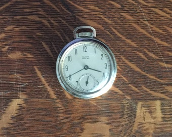 Working pocket watch 1950s vintage Pocket Ben by Westclox with silver face