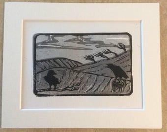 Original, limited edition linocut print of a winter crow field. 'Winter's watchmen'.
