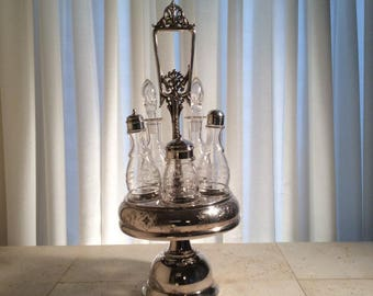 Silver Plated Castor Stand with Five Bottles