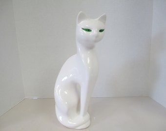 Vintage ceramic green eyed Cat Figurine. used fair condition