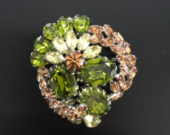 A glamorous vintage Vendome Brooch (Pin) with  green, pink and champagne stones