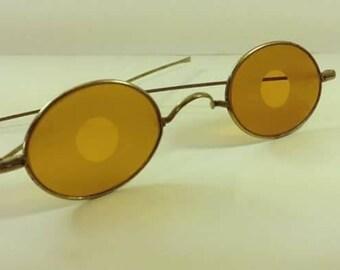 1915, amber glass sunglasses