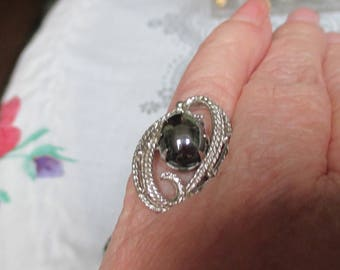 A vtg.Sarah Coventry ring-hematite stone with silvertone--from the 70s--adjustable--oval