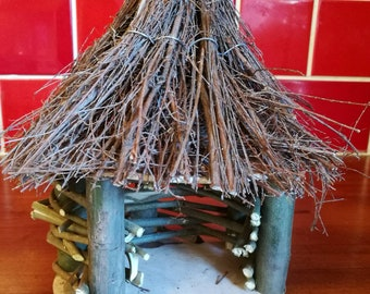 Hand made birdhouse with thatch roof