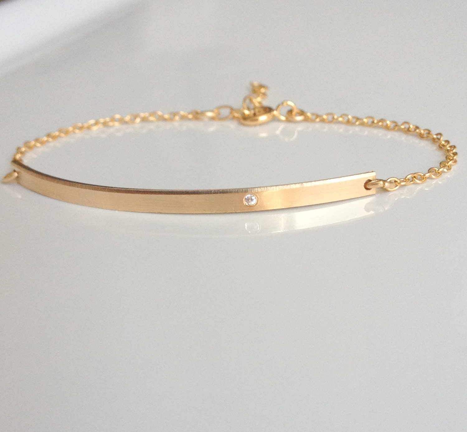 a original curved product with plated seed gold matte beaded g god bar bracelet