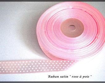 Pink satin ribbon with pastel white dots