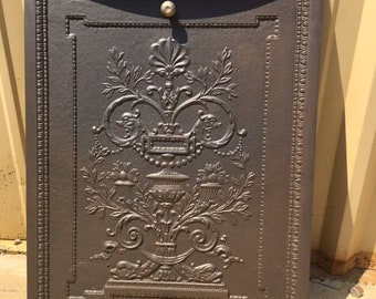 iron fireplace cover. Antique Cast Iron Fireplace Cover with Urn and Flowers Woman Old Ornate Metal