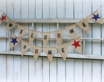 Welcome Home banner with red and blue stars