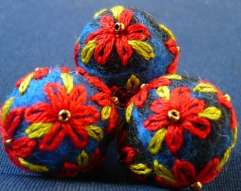 wool felted and embroidered red and green beads