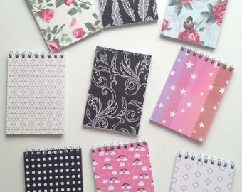 Assorted A7 lined wire bound jotter pocket notebooks black and white rainbow unicorn geometric pastel floral vintage