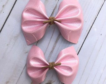 Pink shimmer patent leather hair bow