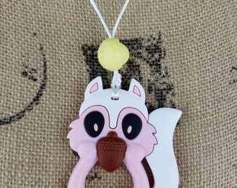 Squirrel chewelry necklace with his nut. 2 different colors to choose from. SPD, Autism, ADHD, fidget. Thin and very flexible.