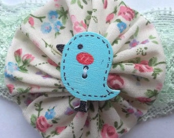 Floral  yo yo headband with blue bird button on mint green lace