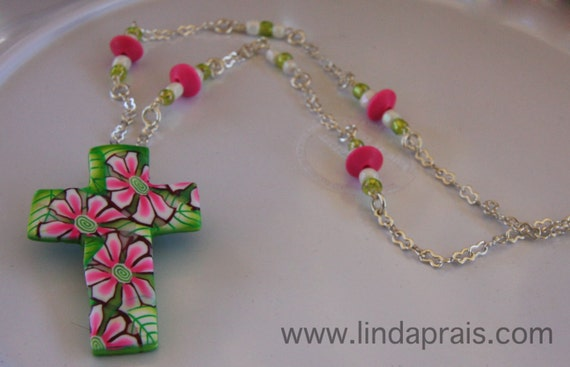 One of a Kind, handcrafted, Vibrant Spring inspired Cross Necklace, boast pink daisy flowers with touches of green variegated leaves.