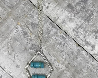 Long silver Chevron necklace with 2 rows of turquoise coloured howlite on a beautiful rolo silver chain, nickel and lead free