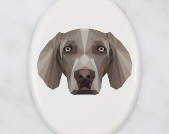 A ceramic tombstone plaque with a Weimaraner dog. Art-Dog geometric dog