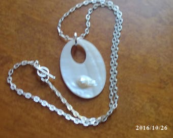 Natural Pearl pendant on silver plated chain