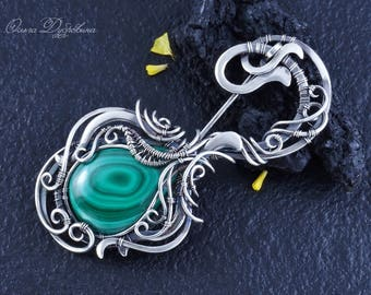 Brooch made of silver with malachite. wire wrap.Fresh of silver