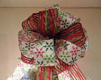 Large christmas tree topper bow white ribbon with red, lime green and traditional green snowflakes and a matching stripe ribbon