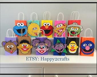 Sesame street die cut characters multicolored favor bags with handles.