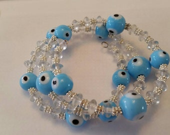 Evil Eye bracelet,  memory wire bracelet, triple tiered bracelet