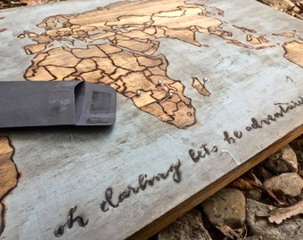 Wood World map to track travels with map tacks