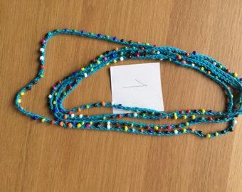 Crochet beaded necklace.
