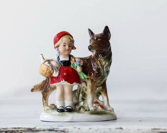 Porcelain figurine of a red cap with a wolf
