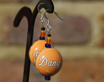 Recycled vintage US orange bottle cap earrings. Dang that's good!  Retro root beer bottle caps made into rounded beads.