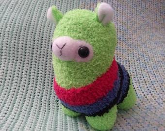 Bright Green Alpaca sock plush in a striped sweater