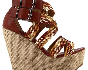 Ceresnia handcrafted wedge sandal with double ankle buckle closure.