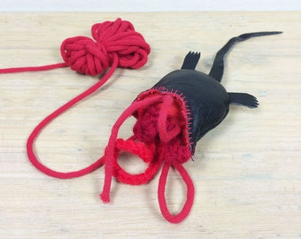 """cat toy """"half a mouse""""   leather mouse with knotted yarn intestines   slightly morbid but great fun for kitties and owners"""